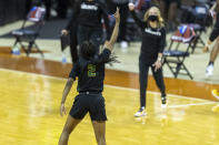 Wright State guard Destyne Jackson celebrates a three-point basket against Arkansas during the first half of a college basketball game in the first round of the women's NCAA tournament at the Frank Erwin Center in Austin, Texas, Monday, March 22, 2021. (AP Photo/Stephen Spillman)