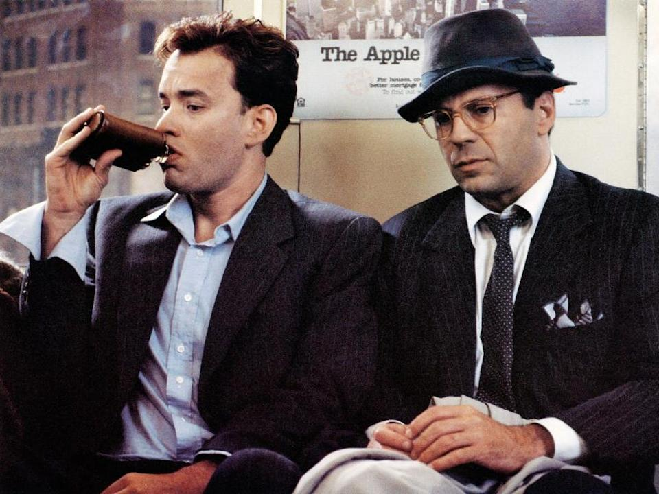 "Tom Hanks and Bruce Willis in ""The Bonfire of the Vanities."""