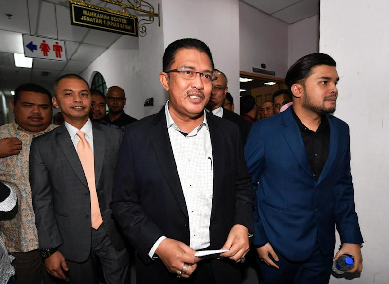 (From left) Amir Sharifuddin Abd Raub, Datuk Abdul Latif Bandi and Ahmad Fauzan Hatim Abd Latif leave the Sessions Court in Johor Baru April 21, 2019. — Bernama pic