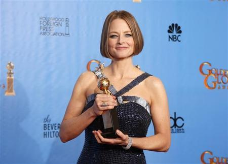 Actress Jodie Foster poses with her Cecil B. DeMille award at the 70th annual Golden Globe Awards in Beverly Hills