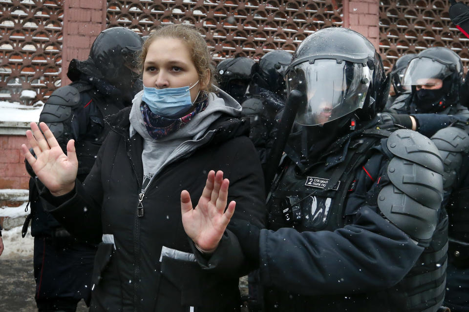 Police officers detain a young demonstrator during a protest near the Matrosskaya Tishina prison where Alexei Navalny is being held, in Moscow, Russia, on Sunday, Jan. 31, 2021. Chanting slogans against President Vladimir Putin, thousands of people took to the streets Sunday across Russia's vast expanse to demand the release of jailed opposition leader Alexei Navalny, keeping up the nationwide protests that have rattled the Kremlin. Over 1,600 were detained by police, according to a monitoring group. (AP Photo/Alexander Zemlianichenko)