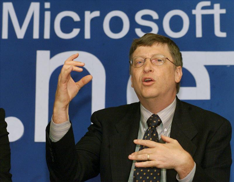 Chairman of Microsoft Corporation Bill Gates gestures during news conference in New Delhi September 14, 2000. Gates, on a day-long visit to boost his company's internet strategy, signed a global strategic deal with Indian software giant Infosys. KK