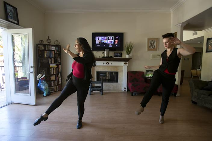 "Instructor Arlene Santos, left, with student Amy Rubinstein during a Queer Latin Dance video class in Santos' living room in Highland Park. <span class=""copyright"">(Gina Ferazzi/Los Angeles Times)</span>"