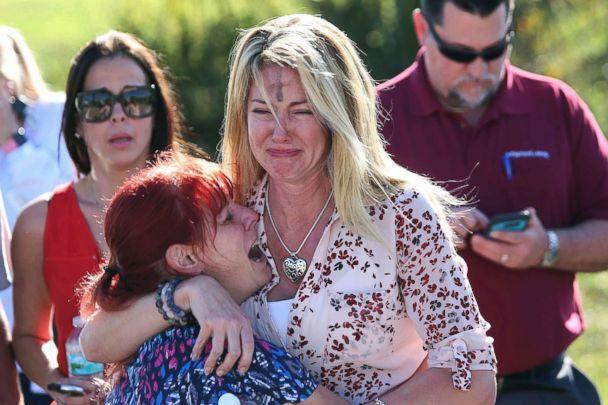 PHOTO: Women cry in an area where parents wait for news after reports of a shooting at Marjory Stoneman Douglas High School in Parkland, Fla., on Feb. 14, 2018. (Joel Auerbach/AP, FILE)