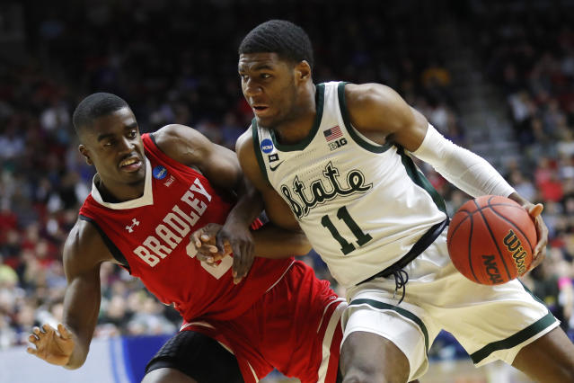 Michigan State forward Aaron Henry (11) drives past Bradley guard Luqman Lundy, left, during a first round men's college basketball game in the NCAA Tournament, Thursday, March 21, 2019, in Des Moines, Iowa. (AP Photo/Charlie Neibergall)