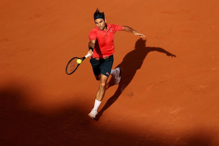 Roger Federer of Switzerland plays a forehand during his men's second round match against Marin Cilic of Croatia during day five of the 2021 French Open at Roland Garros on June 03, 2021 in Paris, France. / Credit: Clive Brunskill / Getty Images