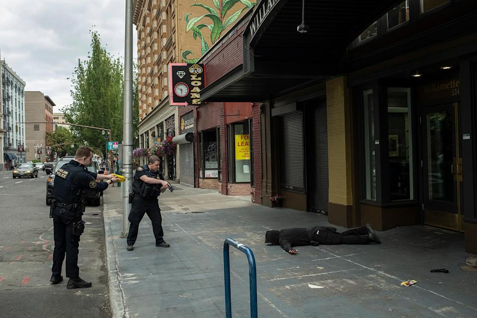 Police disarm and arrest Dennis G. Anderson after he allegedly engaged in a gunfight with anti-fascist activists in Portland on August 22nd. He was charged with unlawful use of a weapon and unlawful possession of a firearm. - Credit: Rian Dundon for Rolling Stone