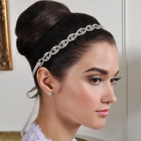 """<div class=""""caption-credit""""> Photo by: Etsy seller AlisaBrides</div><div class=""""caption-title"""">9. Sweet Headband</div>Don't headbands just make you happy? They bring back childhood memories, but they aren't out-of-style in the least. A bedazzled band looks stunning with a half-up, half down look. They also add enough detail to offset a more simple dress. <br> <br> <a rel=""""nofollow noopener"""" href=""""http://www.etsy.com/listing/98555610/new-beautiful-bridal-headband-wedding?ref=sr_gallery_35&ga_search_query=crystal+wedding+headband&ga_view_type=gallery&ga_ship_to=ZZ&ga_min=0&ga_max=0&ga_search_type=handmade"""" target=""""_blank"""" data-ylk=""""slk:Bridal headband"""" class=""""link rapid-noclick-resp"""">Bridal headband</a> by Etsy seller AlisaBrides. <br> <br> <b>Related: <a rel=""""nofollow noopener"""" href=""""http://www.bridalguide.com/beauty-fitness/health-fitness/bridal-body-prep-plan"""" target=""""_blank"""" data-ylk=""""slk:The Four-Week Bridal Bootcamp Plan"""" class=""""link rapid-noclick-resp"""">The Four-Week Bridal Bootcamp Plan</a></b> <br>"""