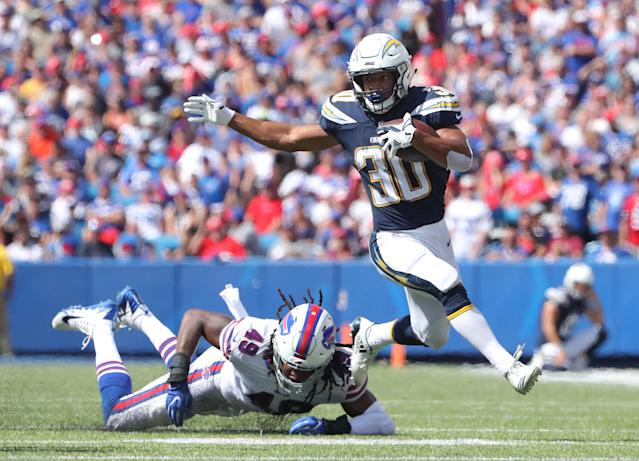 <p>Austin Ekeler #30 of the Los Angeles Chargers gets away from Tremaine Edmunds #49 of the Buffalo Bills during NFL game action at New Era Field on September 16, 2018 in Buffalo, New York. (Photo by Tom Szczerbowski/Getty Images) </p>