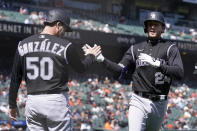 Colorado Rockies' Ryan McMahon, right, celebrates after hitting a two-run home run that also scored Chi Chi Gonzalez (50) during the fifth inning of a baseball game against the San Francisco Giants in San Francisco, Saturday, April 10, 2021. (AP Photo/Jeff Chiu)