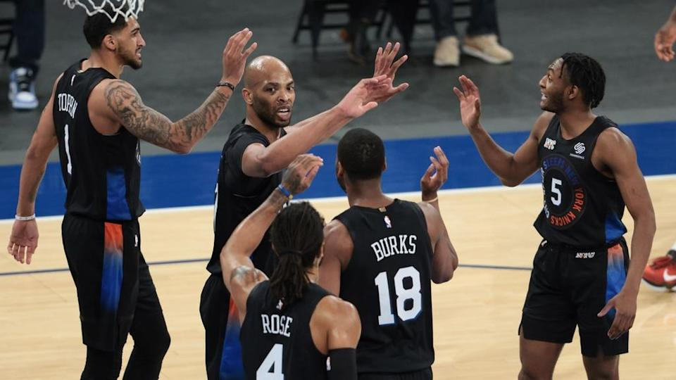 Apr 2, 2021; New York, New York, USA; New York Knicks center Taj Gibson (67) high fives with teammates after blocking a shot during the first half against the Dallas Mavericks at Madison Square Garden.