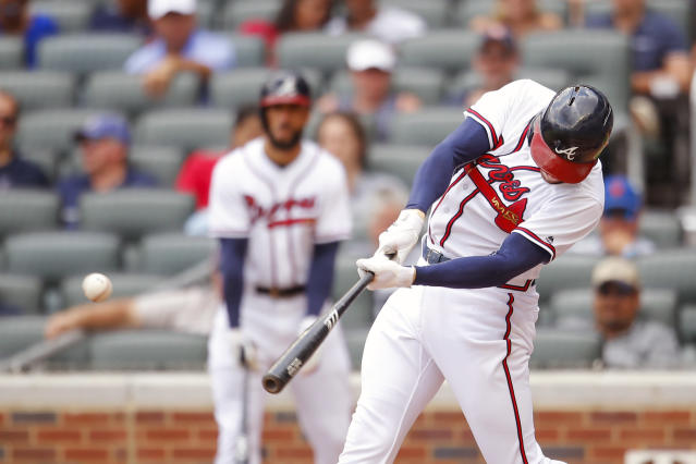 Atlanta Braves Freddie Freeman hits a single to bring in a run in the fourth inning of a baseball game against the New York Mets, Wednesday, June 13, 2018, in Atlanta. (AP Photo/Todd Kirkland)