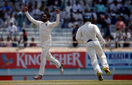 Cricket - India v Australia - Third Test cricket match - Jharkhand State Cricket Association Stadium, Ranchi, India - 17/03/17 - India's Ravindra Jadeja (L) celebrates after dismissing Australia's Matthew Wade. REUTERS/Adnan Abidi