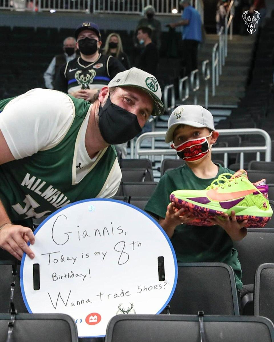 Giannis Antetokounmpo Gifts His Sneakers to 8-Year-Old Fan at Bucks Game