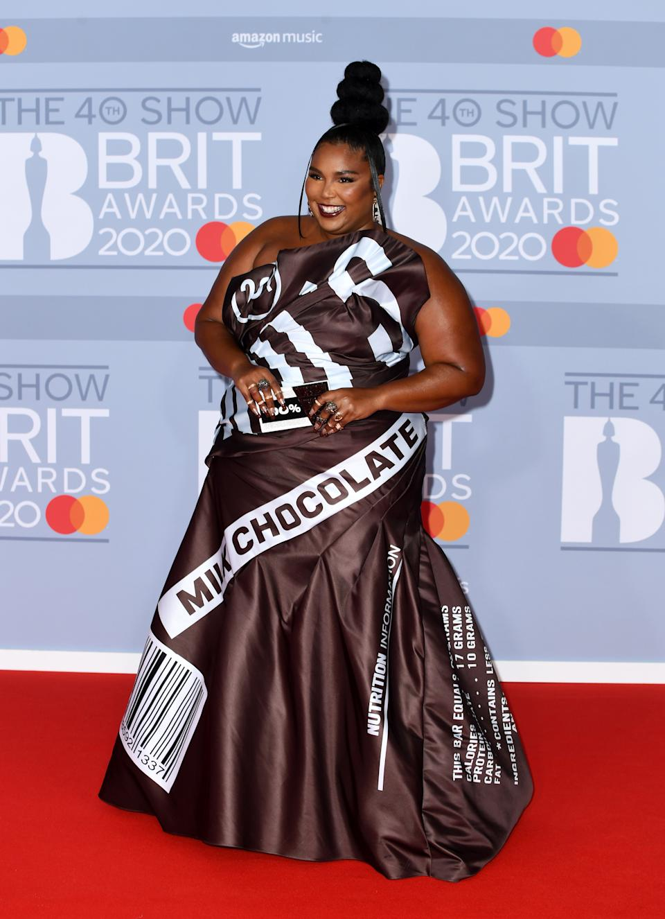 Lizzo wore a chocolate-inspired dress by Moschino to The Brit Awards 2020. (Getty Images)