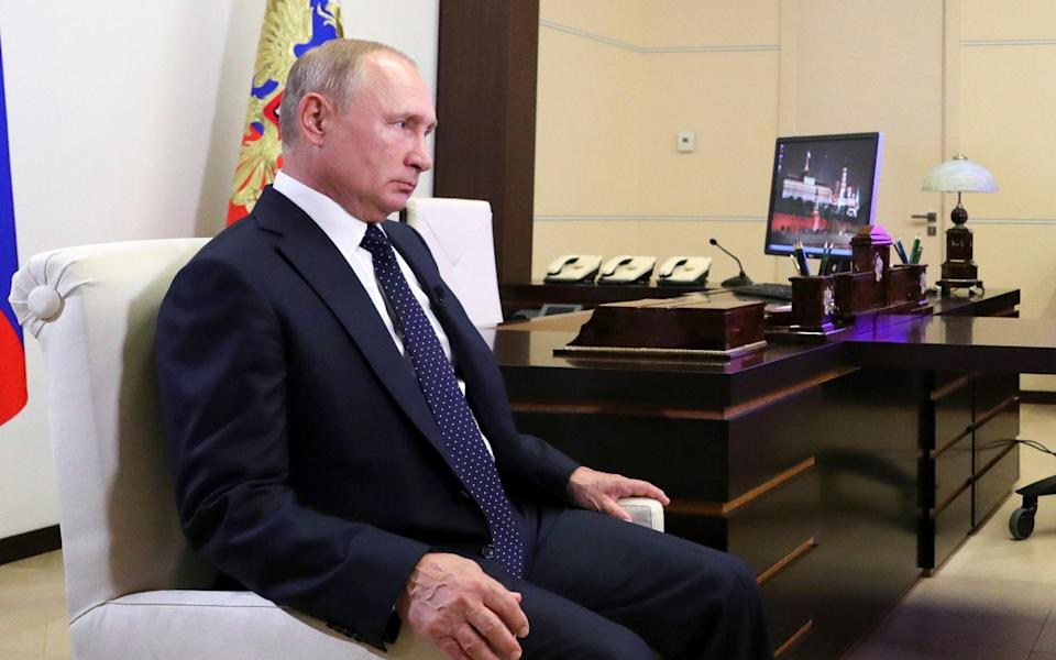 Putin listens to a question during his interview with TV channel 'Russia' - Pool Sputnik Kremlin