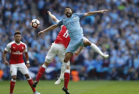 Britain Football Soccer - Arsenal v Manchester City - FA Cup Semi Final - Wembley Stadium - 23/4/17 Manchester City's Gael Clichy in action with Arsenal's Aaron Ramsey Action Images via Reuters / John Sibley Livepic