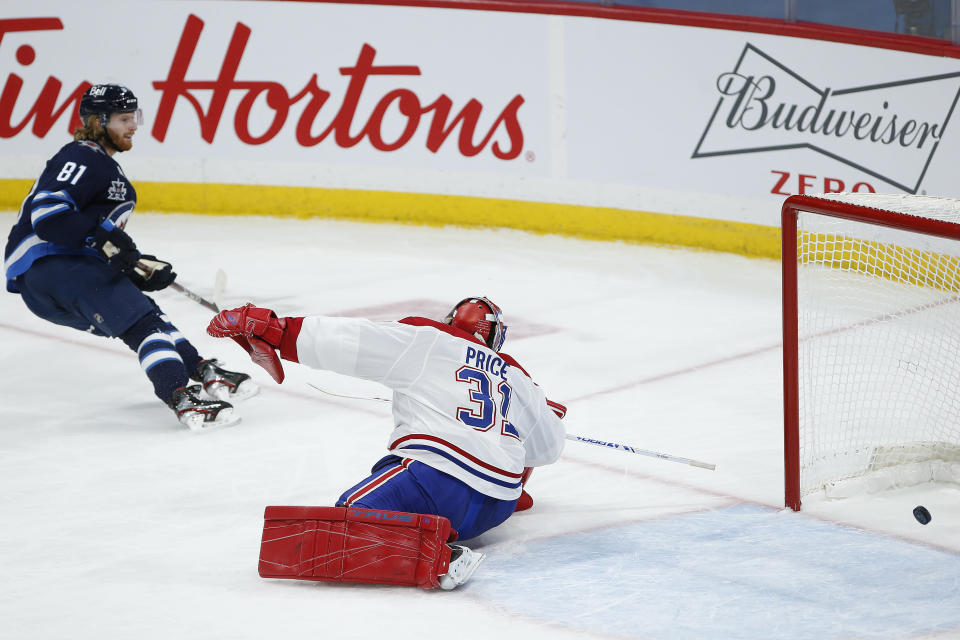 Winnipeg Jets' Kyle Connor (81) scores against Montreal Canadiens goaltender Carey Price (31) during second-period NHL hockey game action in Winnipeg, Manitoba, Thursday, Feb. 25, 2021. (John Woods/The Canadian Press via AP)
