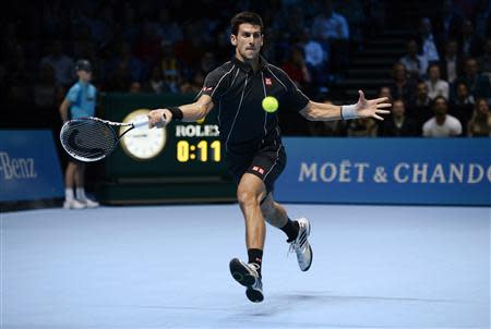 Novak Djokovic of Serbia plays a shot to Rafael Nadal of Spain during their their men's final singles tennis match at the ATP World Tour Finals at the O2 Arena in London November 11, 2013. REUTERS/Dylan Martinez