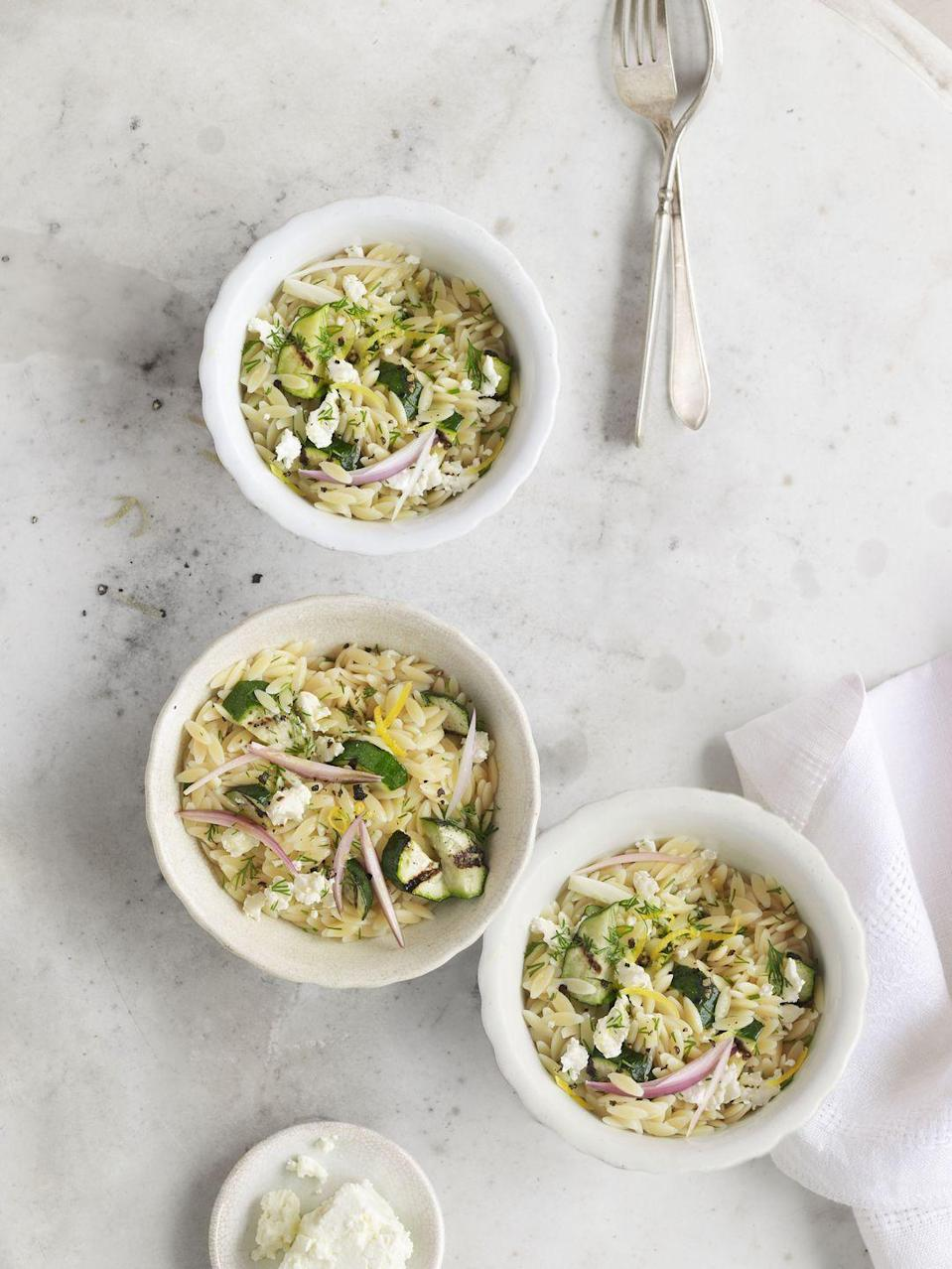"""<p>Elevate this rice-like pasta from simple side to satisfying main with bright Mediterranean touches: tangy citrus, fragrant dill, and salty cheese.</p><p><strong><a href=""""https://www.countryliving.com/food-drinks/recipes/a3886/orzo-zucchini-dill-feta-recipe-clv0512/"""" rel=""""nofollow noopener"""" target=""""_blank"""" data-ylk=""""slk:Get the recipe."""" class=""""link rapid-noclick-resp"""">Get the recipe.</a></strong></p>"""