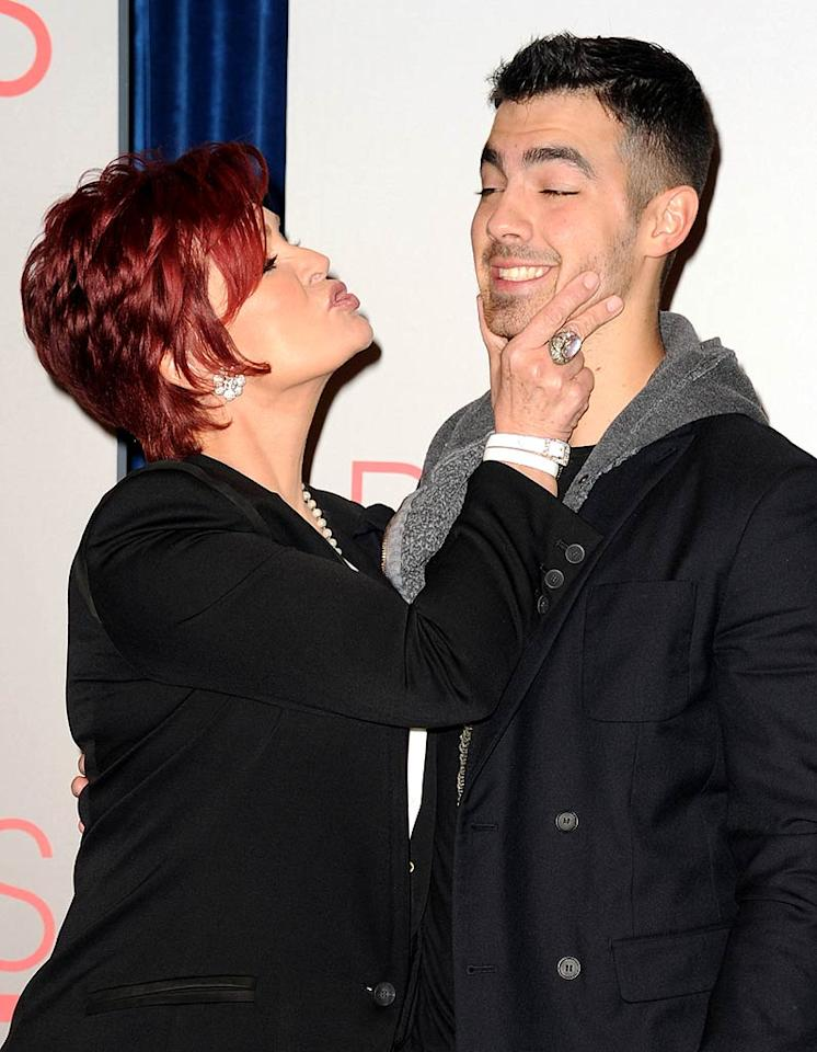"""The Talk"" co-host Sharon Osbourne just couldn't resist giving Joe Jonas' cheeks a big old squeeze at the People's Choice Awards 2012 nominations press conference in Beverly Hills on Tuesday."