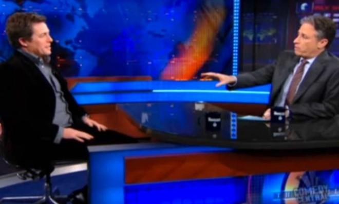 Jon Stewart keeps Hugh Grant at an arm's length during his 2009 appearance on The Daily Show.