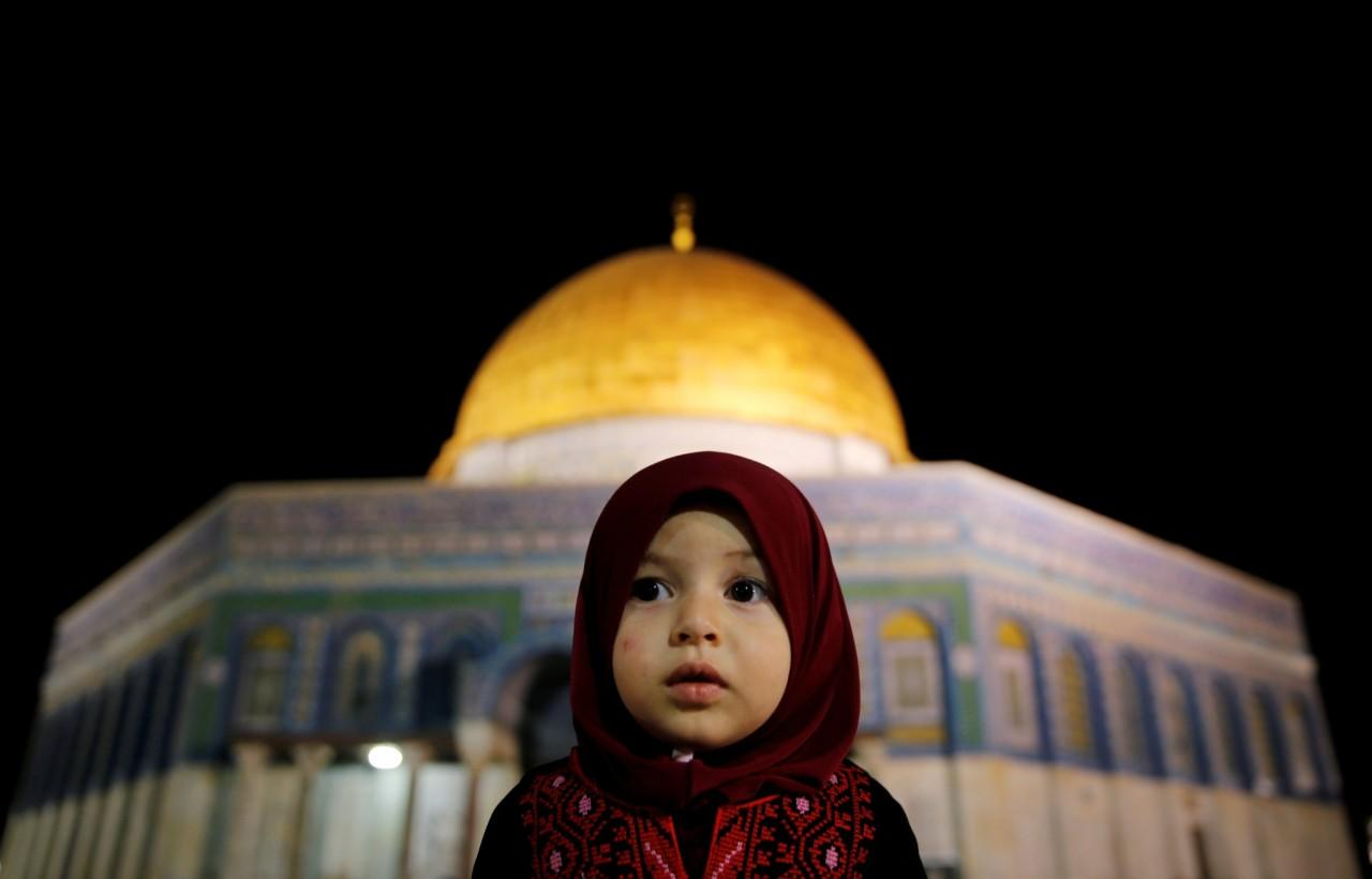 <p>A Palestinian girl prays in front of the Dome of the Rock, at the compound known to Muslims as Noble Sanctuary and to Jews as the Temple Mount, in Jerusalem's Old City during the holy month of Ramadan, June 7, 2016. (Ammar Awad/Reuters) </p>