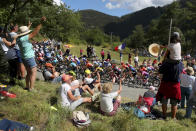 Spectators cheer the riders as they climb Colmiane pass during the second stage of the Tour de France cycling race over 186 kilometers (115,6 miles) with start and finish in Nice, southern France, Sunday, Aug. 30, 2020. (AP Photo/Thibault Camus)