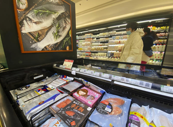 Imported frozen seafood are displayed at a supermarket in Beijing, Friday, Nov. 20, 2020. China has stirred controversy with claims it has detected the coronavirus on packages of imported frozen food. (AP Photo/Ng Han Guan)