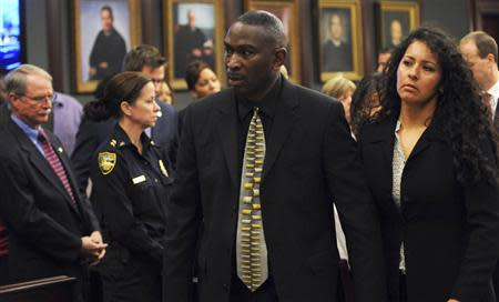 Jordan Davis' father Ronald Davis (C) leaves the courtroom with his wife Carolina (R) as court recessed for the jury to reconsider the first charge against Michael Dunn in Jacksonville, Florida February 15, 2014. REUTERS/ Bob Mack/Florida Times-Union/Pool