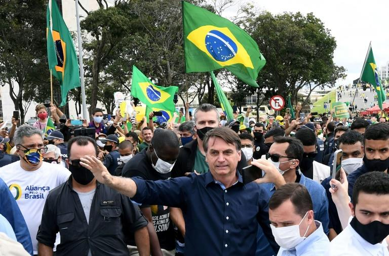 Brazil's health crisis has merged with a political crisis, as far-right President Jair Bolsonaro has openly clashed with local authorities that insist on lockdown measures