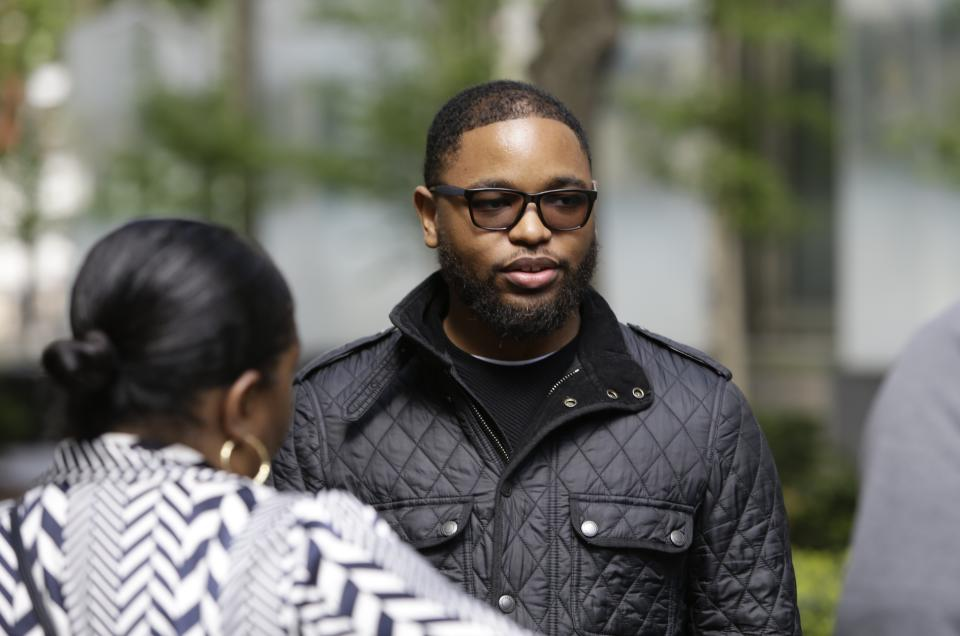 Christian Dawkins stands outside federal court Wednesday, May 8, 2019, in New York. Dawkins and youth basketball coach Merl Code were convicted on a conspiracy count, but acquitted of some other charges. (AP Photo/Frank Franklin II)