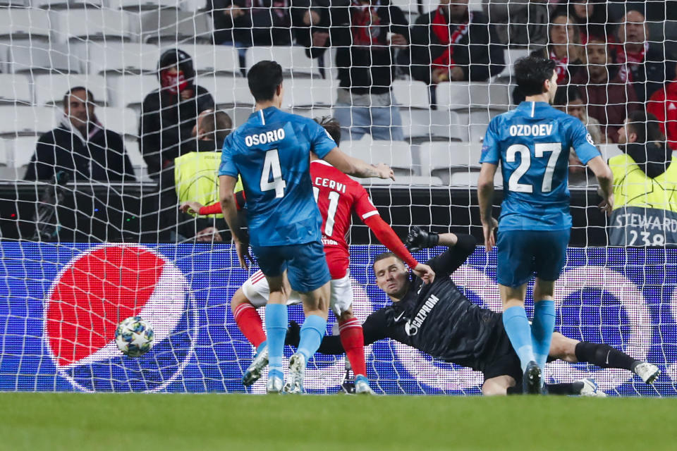 Benfica's Franco Cervi, second left, scores past Zenit goalkeeper Mikhail Kerzhakov the opening goal during the Champions League group G soccer match between Benfica and Zenit St. Petersburg at the Luz stadium in Lisbon, Tuesday, Dec. 10, 2019. (AP Photo/Armando Franca)