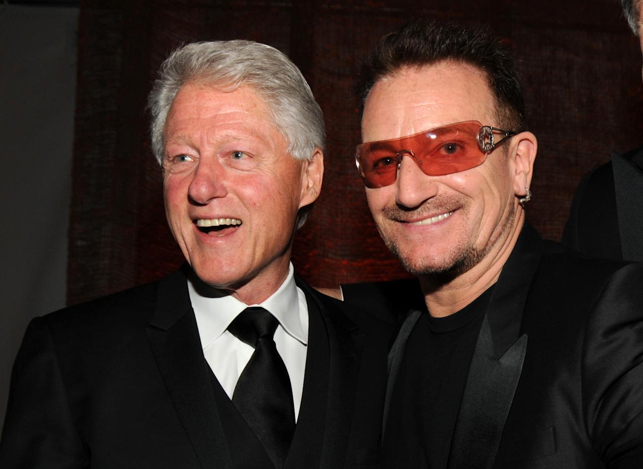 President Bill Clinton and Bono of U2 attend the American Ireland Fund Gala at the Tent at Lincoln Center for the Performing Arts on May 6, 2010 in New York City. (Photo by Kevin Mazur/WireImage)
