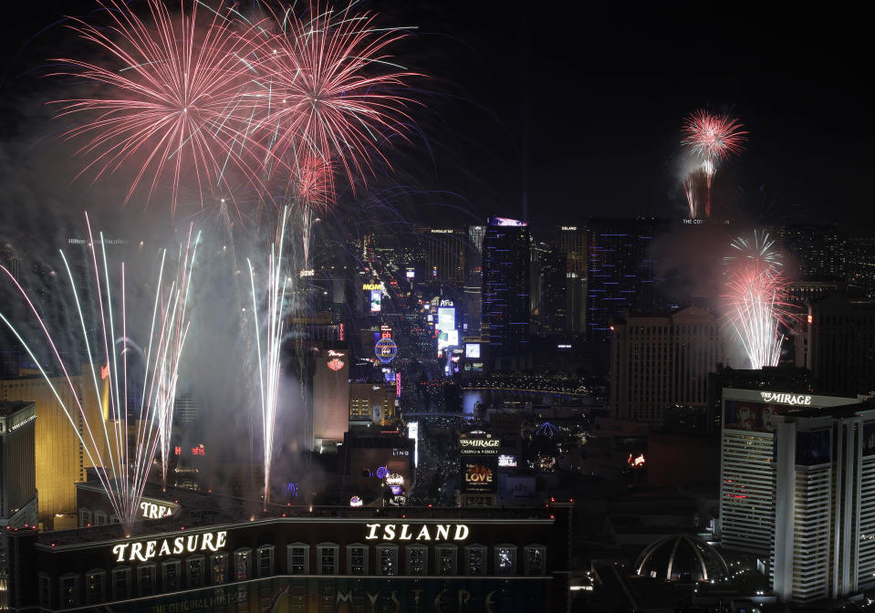 Fireworks explode over the Las Vegas Strip during a New Year's Eve celebration Sunday, Jan. 1, 2017, in Las Vegas. (AP Photo/John Locher)