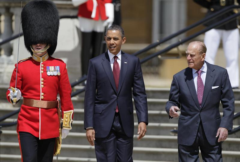 "File - President Barack Obama, center, and Britain's Prince Philip, right, walk to view the Guard of Honor of the Scots Guard during an official arrival ceremony at Buckingham Palace in London, in this Tuesday, May 24, 2011 file photo. Queen Elizabeth II's husband has been taken to the hospital after experiencing chest pains, British royal officials said Friday Dec 23, 2011. A spokeswoman for Buckingham Palace said Prince Philip was taken from Sandringham, the queen's sprawling estate in rural Norfolk, to the cardiac unit at Papworth Hospital in Cambridge for ""precautionary tests."" (AP Photo / Carolyn Kaster, file)"