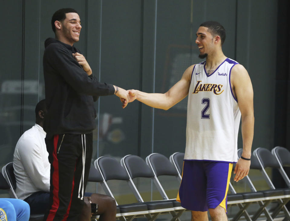 LiAngelo Ball, right, had a pre-draft workout with the Los Angeles Lakers on Tuesday while his brother Lonzo watched on. (AP)