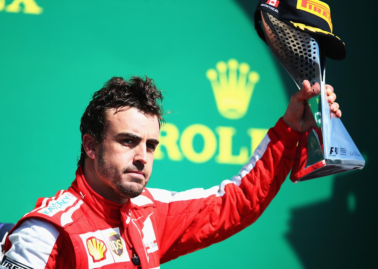 MONTREAL, QC - JUNE 09: Second placed Fernando Alonso of Spain and Ferrari celebrates following the Canadian Formula One Grand Prix at the Circuit Gilles Villeneuve on June 9, 2013 in Montreal, Canada. (Photo by Paul Gilham/Getty Images)