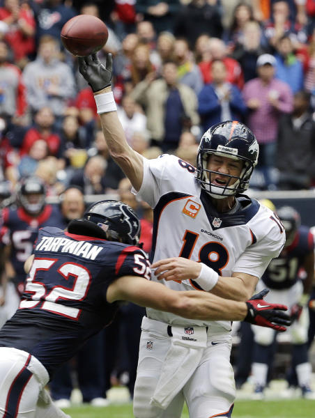 Denver Broncos' Peyton Manning (18) is pressured by Houston Texans' Jeff Tarpinian (52) during the second quarter of an NFL football game on Sunday, Dec. 22, 2013, in Houston. (AP Photo/David J. Phillip)