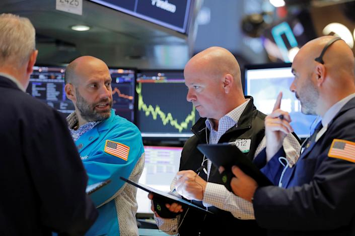 Stock futures pointed to a higher open Monday ahead of a crowded week for corporate earnings. REUTERS/Lucas Jackson
