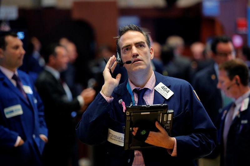 A trader works on the floor of the New York Stock Exchange (NYSE) shortly after the opening bell in New York, U.S., October 19, 2016. REUTERS/Lucas Jackson