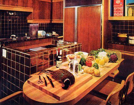 "<p>Don't get distracted by the pheasant. Instead, notice how features like the oversized fridge blend in with the overall design, thanks to the faux wood facade that mimics the cabinets. The tiled kitchen island is cutting-edge at the time, but would eventually be something that would be a ""deal breaker"" to homebuyers decades later. </p>"