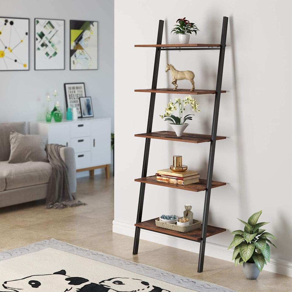 <p>This <span>Homfa Industrial Ladder Shelf</span> ($80, originally $100) will add structure and style to your living room.</p>