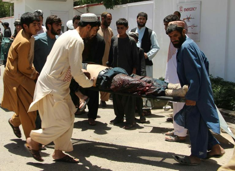 The bomb tore through a queue of civilians and government employees who had lined up outside the bank to collect their salaries ahead of the Eid holidays marking the end of Ramadan
