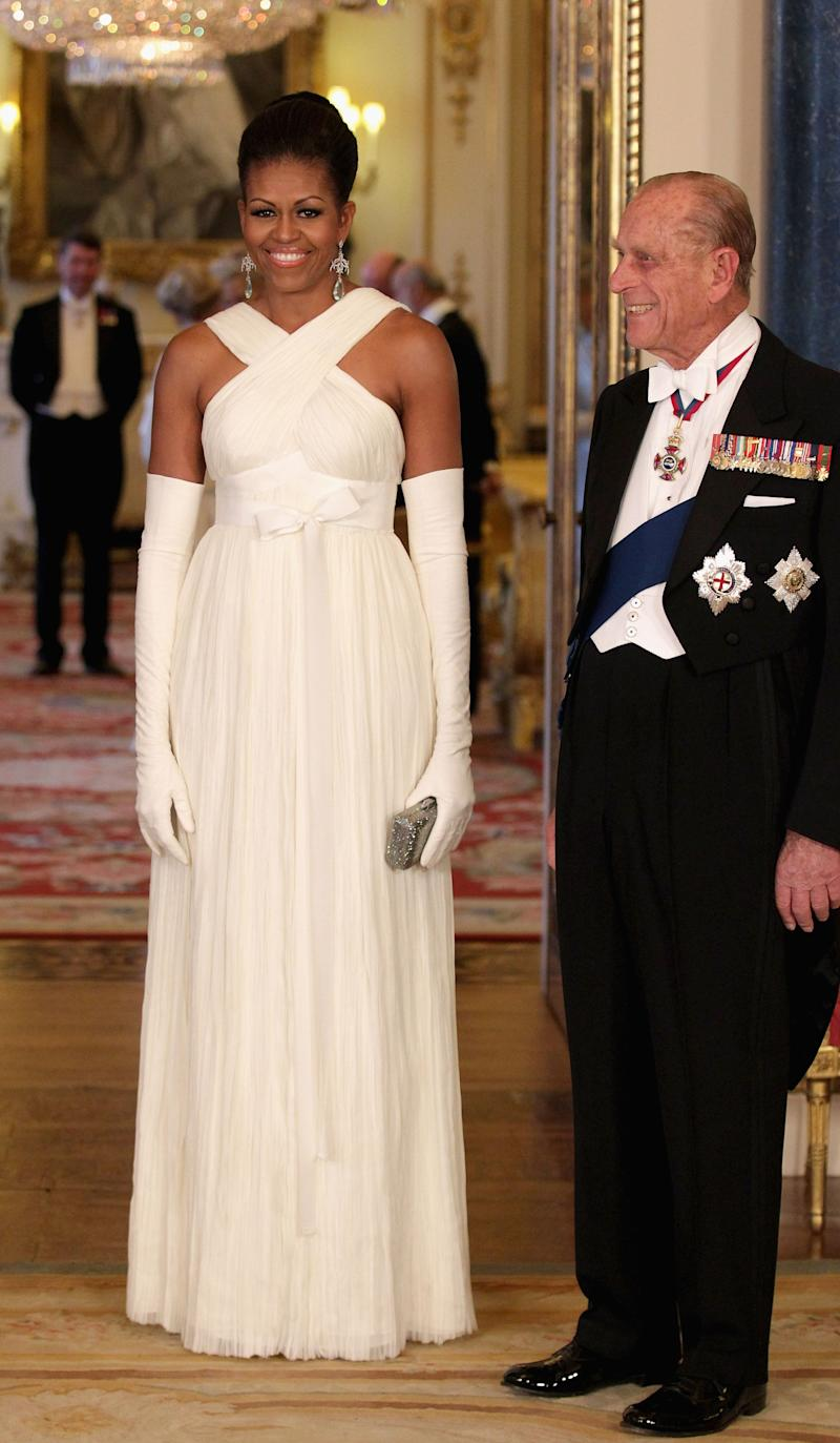 For a visit to Buckingham Palace in 2011, Obama wore a beautiful white gown designed by Tom Ford.
