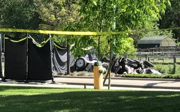 Three people were killed in a single-vehicle crash in Kelowna overnight. The scene of the crash was behind police tape and tarps Wednesday morning.