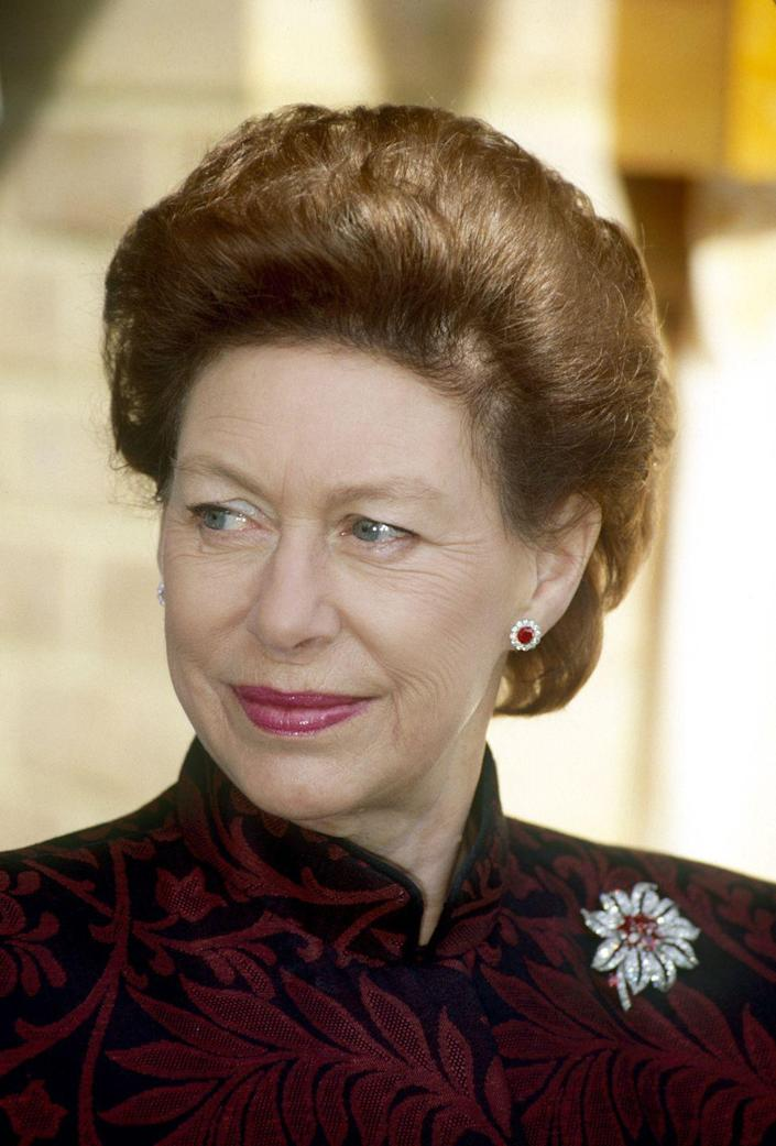 <p>Princess Margaret wore this Cartier diamond and ruby flower brooch throughout her entire life. </p>