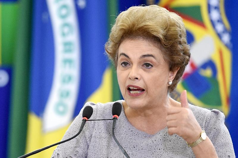 "In a defiant speech from the presidential palace, Brazilian President Dilma Rousseff accused her opponents of seeking to stage a ""coup against democracy"" (AFP Photo/Andressa Anholete)"