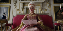 """<p>""""Queen Charlotte is the biggest new character and she's fantastic in every way. I go back and forth between: 'Wow, I wish I'd put her in the books.' And: 'I'm glad I didn't put her in the books because I wouldn't have done her as great as they do her here,'"""" Quinn told <a href=""""https://www.townandcountrymag.com/leisure/arts-and-culture/a34760004/julia-quinn-bridgerton-lady-whistledown-reveal-reaction/"""" rel=""""nofollow noopener"""" target=""""_blank"""" data-ylk=""""slk:Town and Country"""" class=""""link rapid-noclick-resp""""><em>Town and Country</em></a>.</p>"""