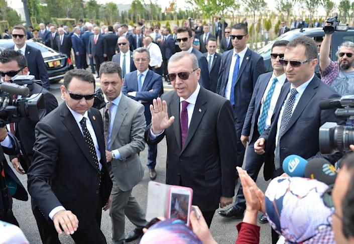 Turkish President Recep Tayyip Erdogan (C) greets supporters as he arrives for the inauguration of the Bayzid I Mosque (Yildrim Bayezid) at the Esenboga International Airport in Ankara, on June 23, 2016 (AFP Photo/Aden Altan)